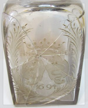 17th century engraved glass bottle with silver cover cap